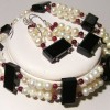 Onyx, garnet and pearl parure
